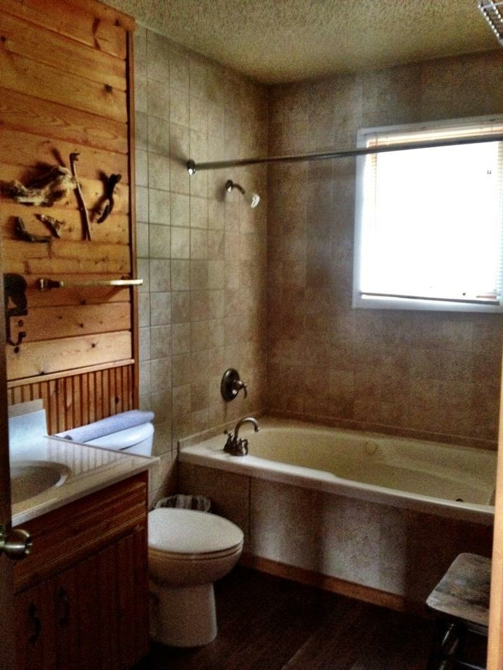 Full bathroom with jet tub